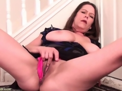 Curvy large tits aged masturbates in a suit