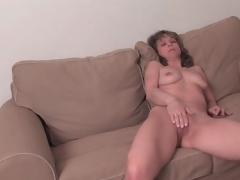 Fit mature chick strips undressed and masturbates