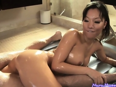 Oriental babe Asa Akira sucking a guy's cock after a slutty nuru massage