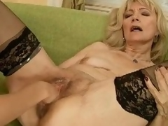 Blonde mature gets fisted and dildoed with a atypical