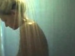 Mature blonde milf with large boobs filmed on hidden webcam taking a shower.